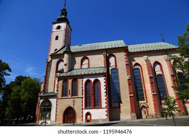 Church of the Assumption of the Blessed Virgin Mary in Banska Bystrica. Exterior against the blue sky. Slovakia. Tourist attraction, tourist destination