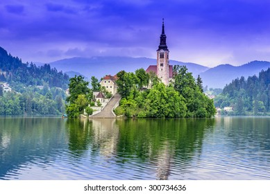 Church of the Assumption in Lake Bled with the castle in the background, Slovenia