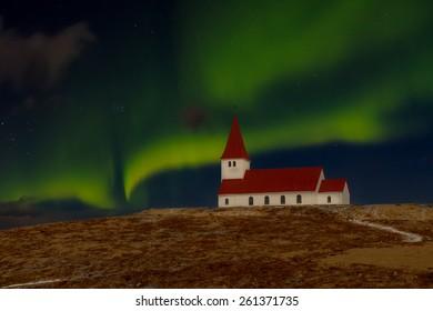 Church and Aurora Borealis in Vik, Iceland, taken in moonlight