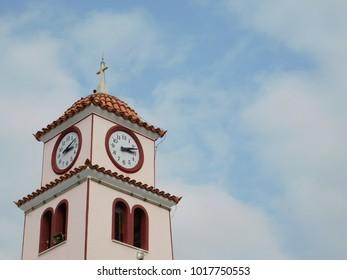 A church bell tower and clock in Glyfada, Attica, Greece