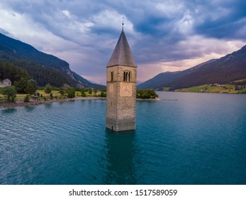 The church bell tower in the Lake Resia in Italy