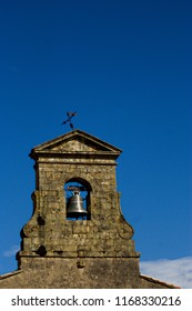 Church bell and tower in the village of Roquefixade, Ariege, France