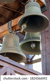 Church bells hanging in a wooden bell tower