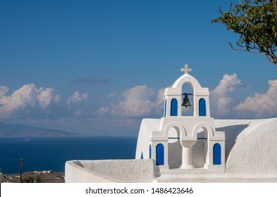 Church bells on a Greek Orthodox Church overlooking the Aegean Sea in the town of Oia on the island of Santorini