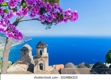 Church belltowers in Ravello village with flowers, Amalfi coast of Italy