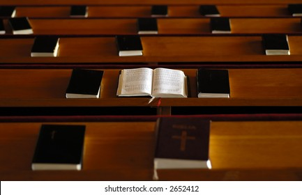 Church benches and books.