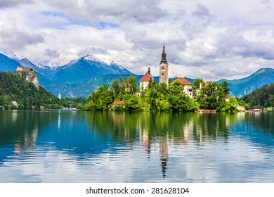 Church of Bled with castle and mountains in background, Slovenia, Europe