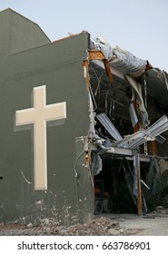 Church building in Tucson with cross on the side being torn down on June 15, 2017
