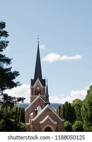 church building under blue sky in Lillehammer, Oppland, Norway