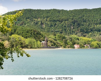 Church and buildings on the shore of Lagoa das Furnas, Sao Miguel, Azores Islands, Portugal