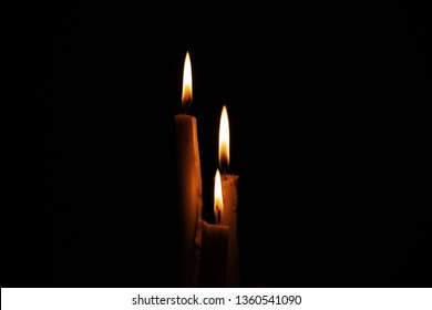 church candle on a dark background