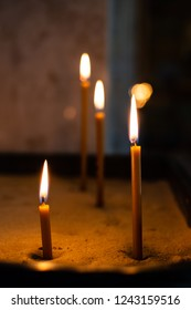 Church candles burn in the temple, visit the temple, put a candle in the temple, a religious holiday, a candle light, the rite of the sacrament of baptism