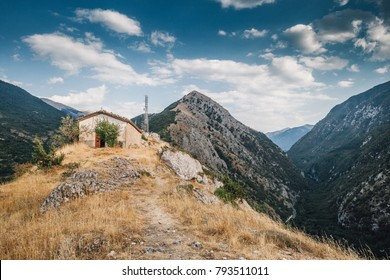 Church with Castrovalva village in the background and the road to Scanno, L'Aquila, Abruzzo, Italy.