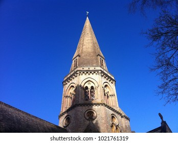 Church Or Cathedral Spire Set Against A Bright Blue Sky. England