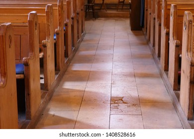 Church chapel aisle with wood pews