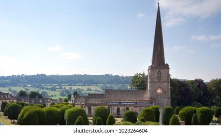 The church and churchyard yew trees at Painswick in the Cotswolds, Gloucestershire, UK