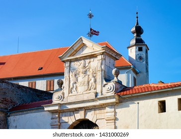 Church clock tower and entrance gate in Ptuj Castle in Slovenia. Architecture of Ptujski grad in Slovenija. Travel
