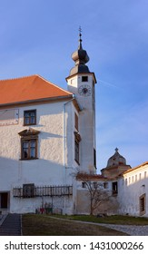 Church clock tower in Ptuj Castle in Slovenia. Architecture of Ptujski grad in Slovenija. Travel