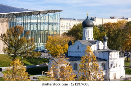Church of conception of Anna, beginning of 16th century against new modern building in park Zaryadye in autumn. Moscow, Russia