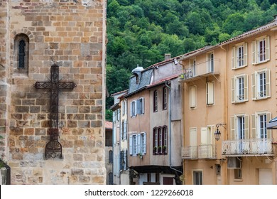 Church cross and houses in the Villa de Foix near the Pyrenees and Andorra. Ariege France