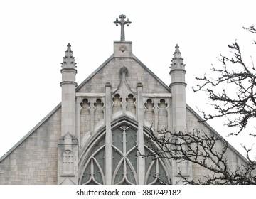 Church Cross in Winter sky in Kalamazoo Michigan