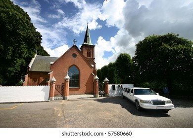 Church  in denmark a sunny summer day, limousine waiting for the  couple to come out of the church
