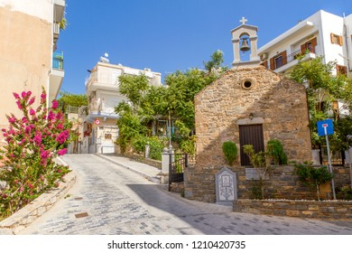 Church of Divine Mother in the narrow street of Agios Nikolaos. Sumer day. Crete Island. Greece