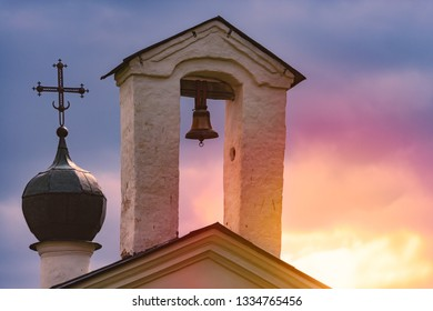Church dome and bell tower in Russia at sunset