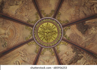 Church dome interior gold painted dove with paintings all around