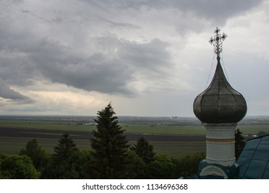 Church dome and view of the fields. Russia, Kholmogory district, Matigory