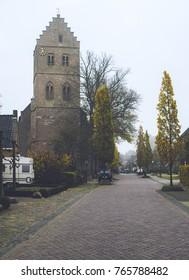 Church in dutch village with autumn trees. Geesteren, Achterhoek, Netherlands.