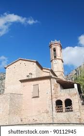 Church of El Bruc in Catalonia, Spain, over a blue sky
