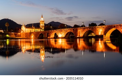 church at the end of the Roman bridge of Ponte de Lima, in Minho, Portugal. Blue hour
