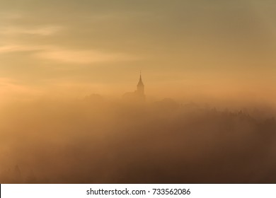 Church in fog, on a hill, sunrise, early morning