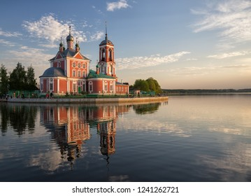 Church of the Forty Martyrs of Sebaste reflected in water of Lake Pleshcheyevo at sunset, Pereslavl-Zalessky, Russia
