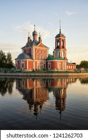 Church of the Forty Sebastian Martyrs reflected in water of Lake Pleshcheyevo at sunset, Pereslavl-Zalessky, Russia