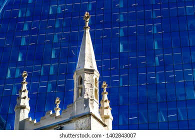 Church in front of modern skyscraper facade in London, Great Britain.