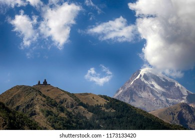 Church in Gergeti and a beautiful view of the Kazbek mountain in Georgia
