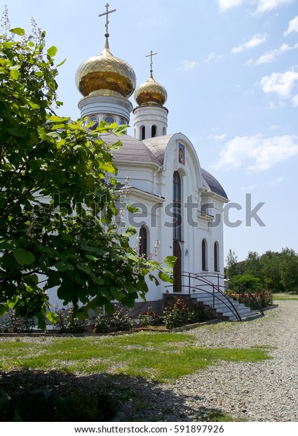 the Church with the Golden domes against the blue sky