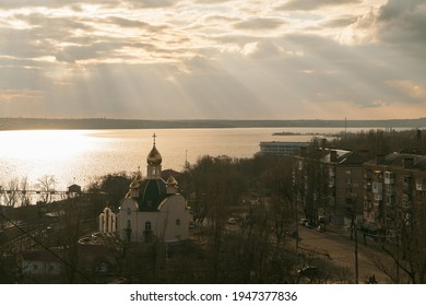 the church with golden domes. Dome of the church reflecting floating sky. Aerial image of the Eastern Orthodox Church on the river