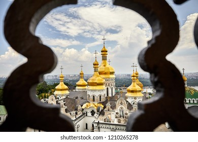 Church with golden domes at Kiev Pechersk Lavra Christian complex. Old historical architecture in Kiev, Ukraine
