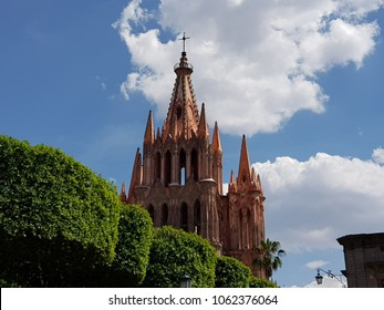 Church with Gothic architecture in San Miguel de Allende, Mexico, and blue sky, seen from the Park