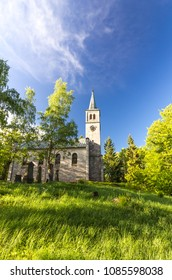 Church and graveyard in the forest and grass