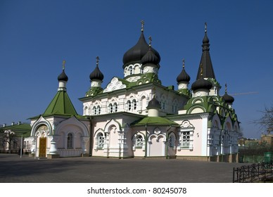 church with green roof and black domes
