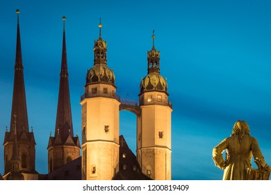 The church of Halle Saale in Germany and the Haendel statue at dusk