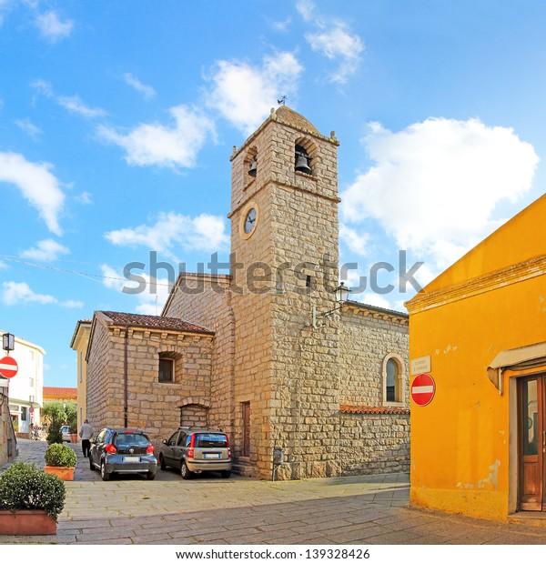 "Church in the heart of Arzachena. Arzachena is a town in the province of Olbia-Tempio, Sardinia, Italy. Arzachena is the administrative capital of the ""Costa Smeralda"" tourist area."