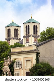 "Church of Holy Andrew, Mirabell palace and Mirabell garden with sculpture ""Paris steals Elena"" in Salzburg, Austria"