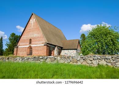Church of the Holy Cross (Hattulan Seurakunta) on a sunny June day. Hattula, Finland