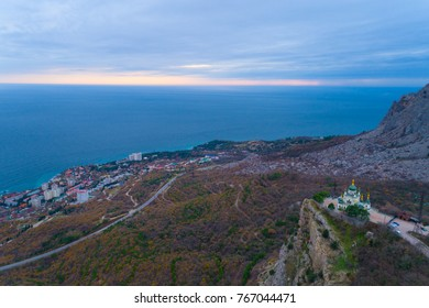 Church of Holy Resurrection of Christ on Red cliff and township Foros on Black sea coast, Crimea, Russia.