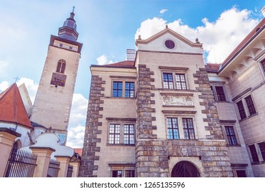 Church of the Holy Spirit and the castle, Telc, Czech republic. Architectural scene. Unesco World Heritage Site. Purple photo filter.
